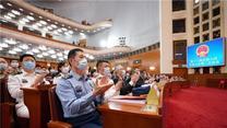 十三屆全國人大三次會議在京勝利閉幕